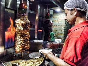 enjoying a roll at fanoo's. bangalore, india. march 2015.