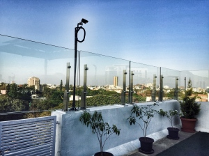 enjoying a view of the city center from the terrace garden at st marks hotel. bangalore, india. march 2015.