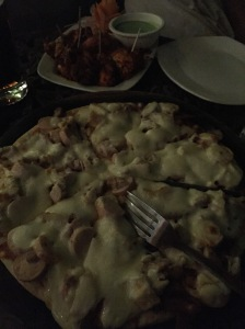 meat lover's pizza at the local. bangalore, india. march 2015.
