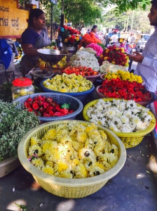roadside flower stall. bangalore, india. april 2015.