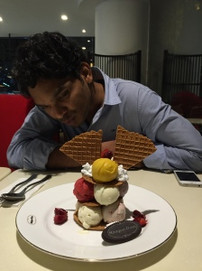 he couldn't get over how much ice cream we had managed to order. bangalore, india. april 2015.
