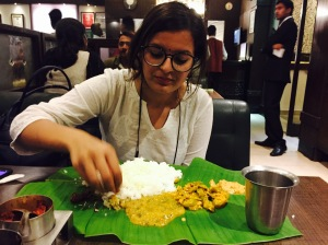 introducing my work wife to her first meal on a banana leaf. bangalore, india. april 2015.