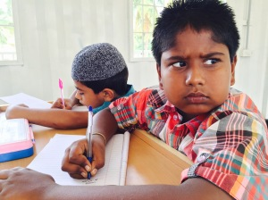 my favourite little buddy in one of the summer camp centers. malavalli, india. april 2015.