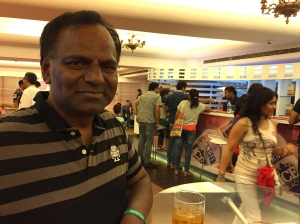 enjoying the free food and drinks. bangalore, india. may 2015.