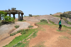 bettina explores the top of the monolith. savandurga, india. may 2015.