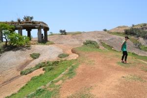 bettina explores the top of the monolith. savandurga, india. may 2015.