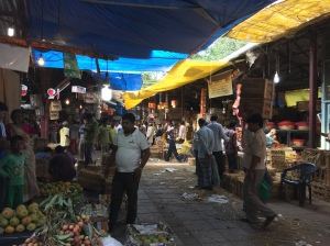 strolling through crawford market on a sunday morning. bombay, india. may 2015.