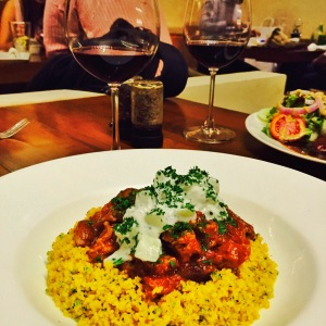 lamb shanks, couscous, and a glass of red wine. now that's what i call a good night. bombay, india. may 2015.
