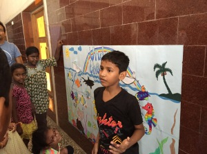 govind explaining our mural to the parents. bombay, india. may 2015.