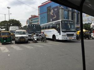 buses leaving the shantinagar bus station. bangalore, india. march 2015.
