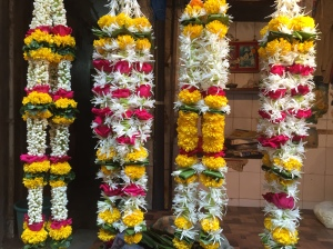 all the garlands lined up and ready for celebrations. bombay, india. may 2015.