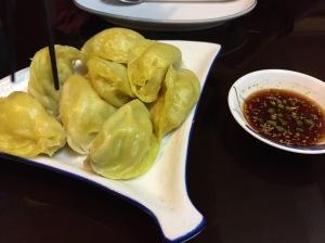 pork dumplings with sauce. bangalore, india. june 2015.