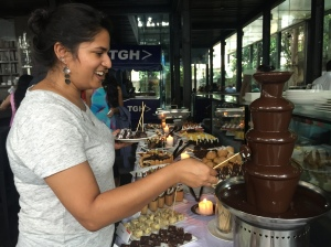 having fun at the chocolate fountain. bangalore, india. september 2015.