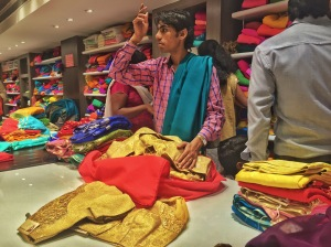 saree shopping is some serious business. bangalore, india. october 2015.