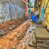 rainy days + dug-up streets = a muddy mess on the way to work. bangalore, india. november 2015.