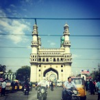 driving past the charminar. hyderabad, india. january 2015.