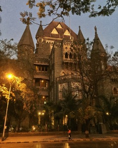 strolling around south bombay during the magical twilight hour. bombay, india. february 2016.