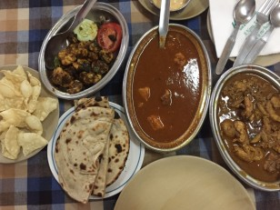 pappadum, prawns, parota, pork vindaloo, and kerala special curry. bangalore, india. february 2016.