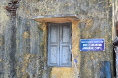 old buildings and bilingual street signs. pondicherry, india. march 2016.