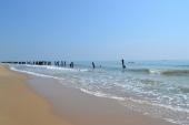 beach walking. pondicherry, india. march 2016.