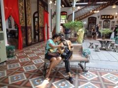 making friends at the pinang peranakan museum. george town, malaysia. april 2016.
