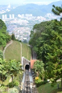 watching the views of george town appear on the way up penang hill. penang, malaysia. april 2016.