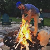 lannon builds a fire. great barrington, massachusetts. july 2016.