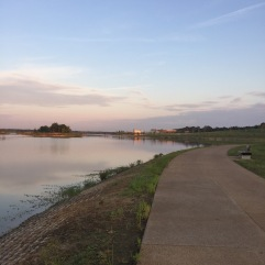 early morning run around the shelby farms lake. memphis, tennessee. september 2016.